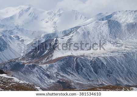 Winter fog in the high mountains in the afternoon - stock photo
