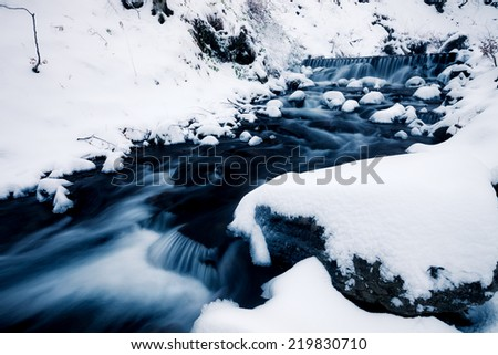 Winter forest creek - stock photo