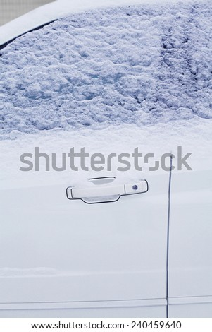 Winter freezing car window, frozen vehicle in the snow, cold day - stock photo