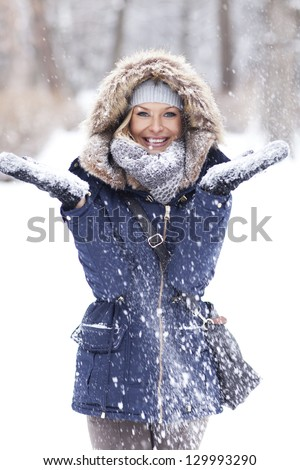 Winter frenzy. Beautiful girl walking in the park in winter.  - stock photo