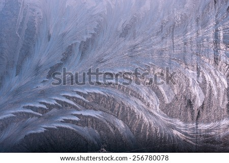 Winter fros-twork on window glass useful as texture background  - stock photo