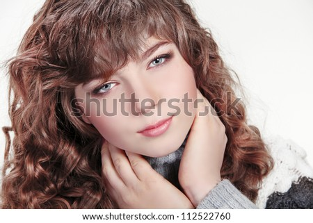 winter girl. Beautiful Woman with Healthy Curly Hair - stock photo