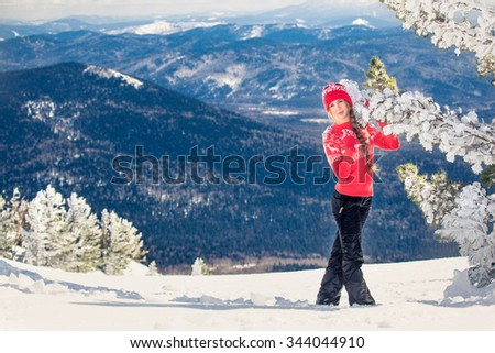 winter girl behind snow tree and mountain - stock photo