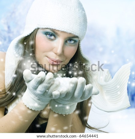 Winter Girl Blowing Snow - stock photo