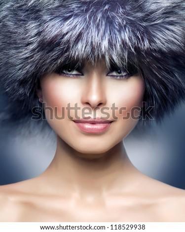 Winter Girl. Fur Fashion. Beautiful Woman in Fur Hat. Winter Woman Portrait - stock photo