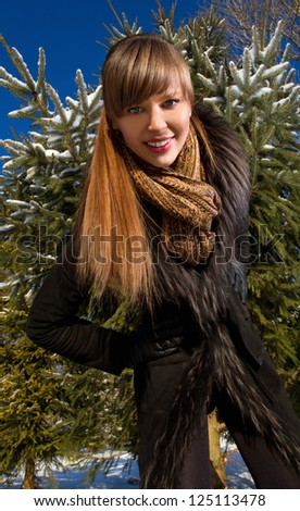 Winter Girl in   Fur Coat - stock photo