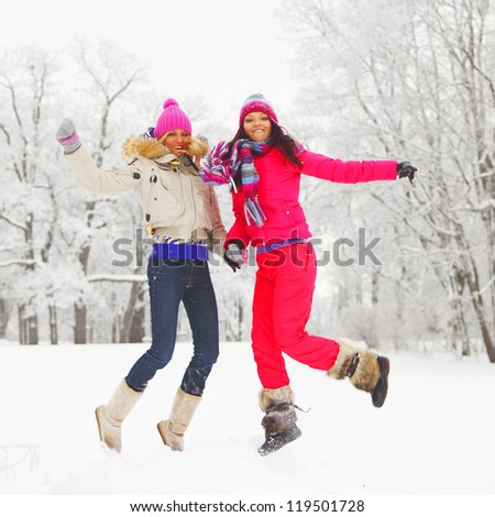 winter girl jump on snow background - stock photo
