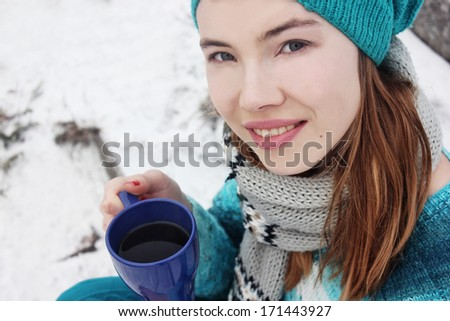 Winter girl or Drinking coffee