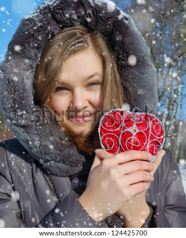 Winter girl with a decorative heart