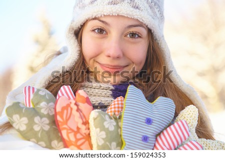 Winter. Girl with heart shapes outdoor.