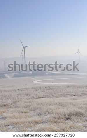 winter grassland with wind Turbines in inner mongolia china - stock photo