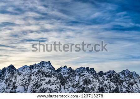 Winter High Tatras mountains landscape with blue cloudy sky - stock photo