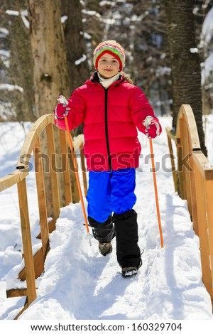 Winter hike -  young girl in winter forest - stock photo