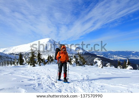 Winter hiking in the mountains on snowshoes. - stock photo