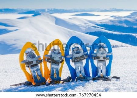 Winter hiking in the mountains. Snowshoes in snow with beautiful landscape