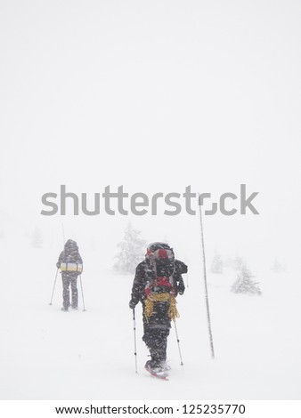 winter hiking with snow shoes - on the top of low Tatra mountains - stock photo