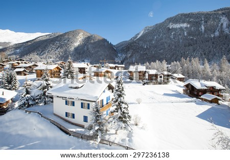 Winter holiday houses in swiss alps - stock photo