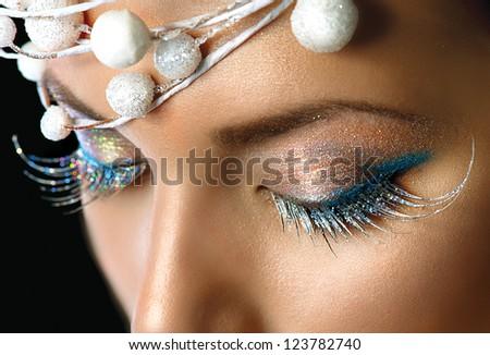 Winter Holiday Make-up closeup. Christmas Party Eyes Makeup detail - stock photo
