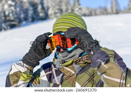 Winter holiday - portrait of a man wearing balaclava and ski glasses  - stock photo