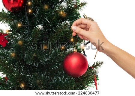 People Decorating For Christmas