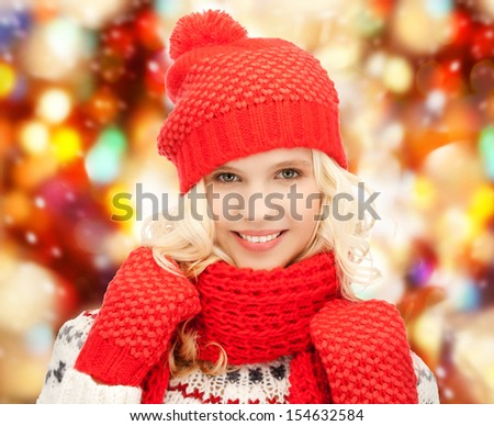 winter, holidays, christmas concept - beautiful teenage girl in hat, muffler and mittens - stock photo
