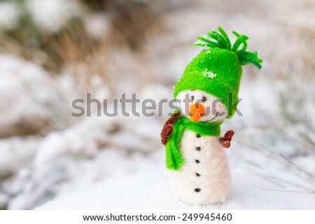 Winter holidays or Christmas background - Happy, smiling, cute and cheerful  snowman on snow (copy space) - stock photo