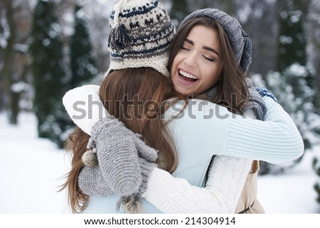 Winter hugs of the best friends  - stock photo