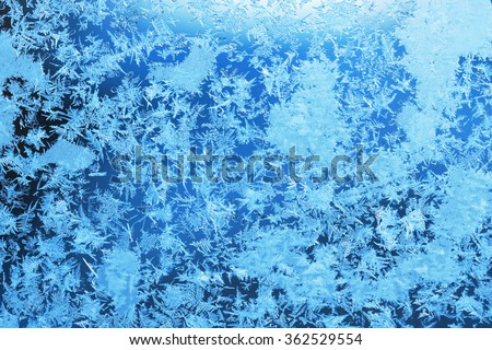 Winter ice frost, frozen background. frosted window glass texture. Cold cool icicles background. Winter wonderland scene. Christmas fresh, New Year background - stock photo