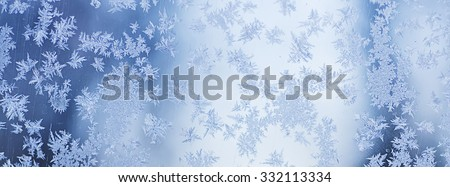 Winter iced blue pattern with snowflakes, holiday seasonal background - long horizontal - stock photo