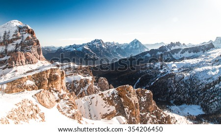 winter in the italian alps, with the ski slope full of snow - stock photo