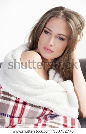 winter is coming, beautiful young woman covered with warm blanket