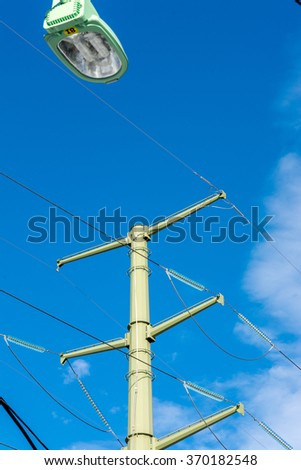 Winter is winter. Electric power line â?? always look solid.  Blue sky as a background.
