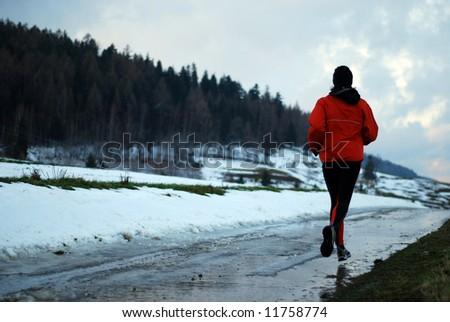 Winter jogging - stock photo