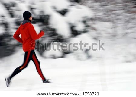 Winter jogging, intentional motion blur - stock photo