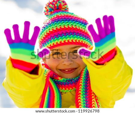 Winter, kid - lovely girl has a fun in snow - stock photo