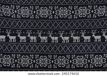 winter knitted pattern with deer and snowflakes, background - stock photo