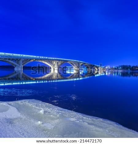 winter Kyiv metro bridge at night - stock photo
