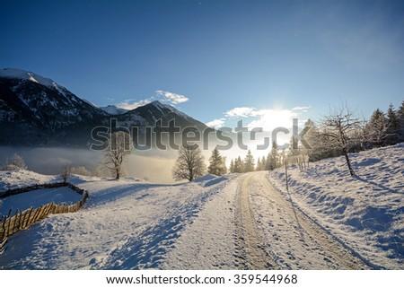 Winter landscape and country road, Gasteinertal valley near Bad Gastein, Pongau Alps - Salzburg Austria Europe - stock photo