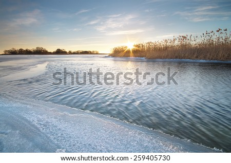 Winter landscape and icy river. Nature composition. - stock photo