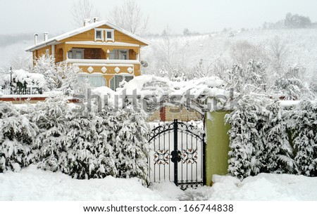winter landscape and rural homes in the area - stock photo