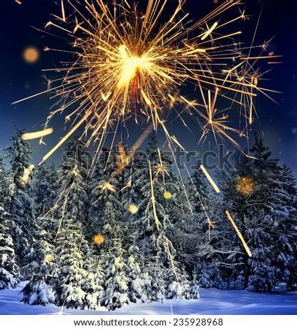 winter landscape and sparkler - christmas  - stock photo