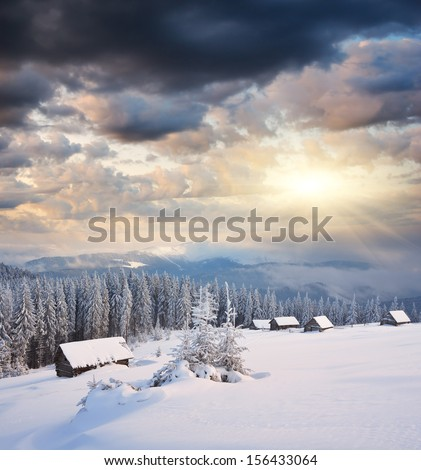 Winter landscape at night in the mountains. Fabulous sunshine - stock photo