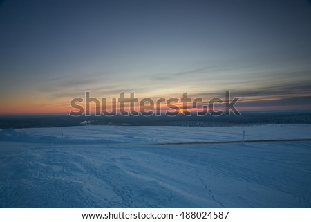 Winter landscape during sunrise near Ivalo, Finland.