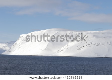 Winter landscape from a ship in Norwegian sea North of Norway