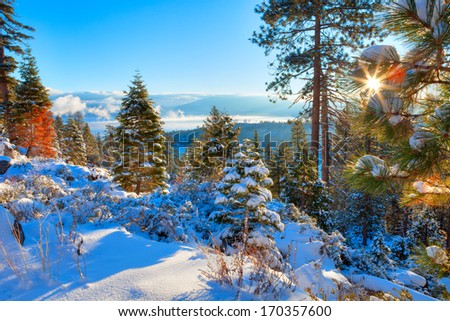 Winter landscape from Lake Tahoe, with Sun star. - stock photo
