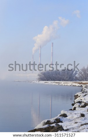 winter landscape Hydroelectric in dense fog early in the morning at sunrise