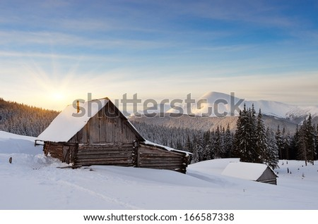 Winter landscape in the early morning. Hut in a mountain valley. Carpathian mountains, Ukraine, Europe - stock photo