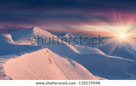 Winter landscape in the mountains. Sunrise - stock photo