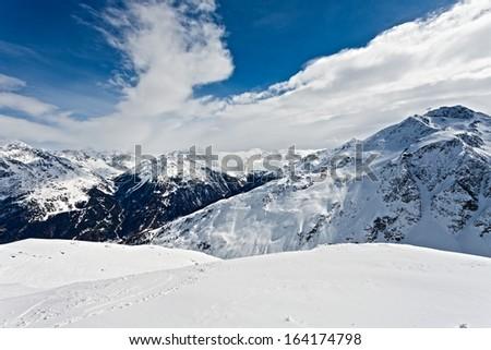 Winter landscape of a ski resort in the alps - stock photo