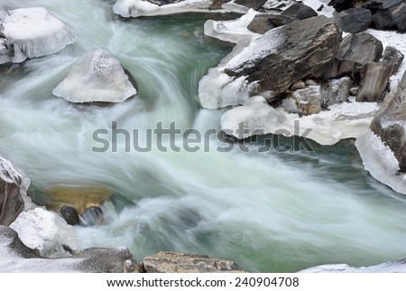 Winter landscape of Clear Creek captured with motion blur, Rocky Mountains, Colorado, USA - stock photo